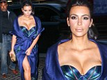 Isn't it supposed to be Khloe's birthday? Kim Kardashian ensures all eyes are on her in plunging corset dress for sister's yacht party