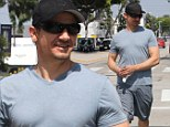 He's pumped up! Jeremy Renner shows off impressively toned and bulging biceps as he steps out from gym