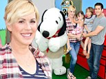Platinum blonde Molly Ringwald and her family pose with Snoopy at Knott's Berry Farm