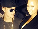 Eyes front Justin! Bieber can't stop himself from staring at busty Amber Rose's cleavage