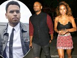 The Chris Brown reality show! BET 'in talks to do docu-series on rapper' amid court trial woes... as Karreuche Tran parties with mystery man at nightclub