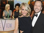 Making a quick getaway? Jenny McCarthy 'flees to Turks and Caicos' with fianc� Donnie Wahlberg after being dumped from The View
