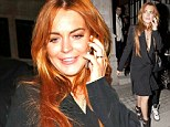 Nothing Freaky (Friday) about this! Lindsay Lohan steps out in plunging tuxedo dress and platform heels as she heads to Chiltern Firehouse