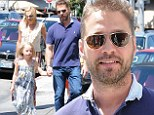 Brandon Walsh back in the hood! 90210 star Jason Priestley looks ever youthful as he takes his family to lunch in Beverly Hills