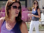 Cindy Crawford & husband Rande Gerber stop at a wine store and pick up a couple of bottles of white wine in Malibu, California on Friday