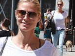Pep in her step: Heidi Klum was stylish in grey stilettos as she perked up with a large Starbucks drink in New York on Saturday