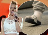 The show must go on! Iggy Azalea busts some moves hitting Miami stage in silver trainers after losing a toenail while playing soccer game