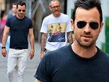 Justin Theroux lightens up his trademark dark style with white jeans during NY stroll with famed photographer Terry Richardson