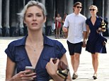 Loved-up tourists! Josh Hartnett and girlfriend Tamsin Egerton keep each other close as they visit Venice's sights while regularly taking snaps