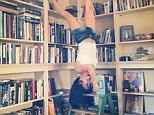 Be careful! Hilaria Baldwin reads classic novel upside down on a LADDER for latest daily yoga pose