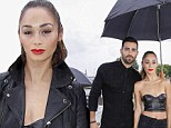 Jesse Metcalfe and girlfriend Cara Santana shield their black ensembles with umbrella at drenched Kenzo runway show in Paris