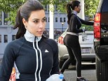 Booty camp! Kim Kardashian displays her derriere as she hits the gym bright and early the morning after Khloe's birthday party