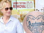 Erasing Antonio? Melanie Griffith seen leaving tattoo removal office... after covering Banderas love ink with makeup on carpet last week
