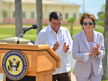 Texas State rep. Eddie Lucio III, left, walks with U.S. House Minority Leader Nancy Pelosi after a news conference on Saturday, June 28, 2014, in Brownsville...
