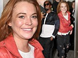 Dressing the part? Lindsay Lohan wears ripped jeans to DJ at London club... and her old pal Diddy comes along to watch