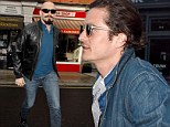 Casual customer! Orlando Bloom sports double denim and high-top trainers as he joins Hugh Jackman at Chiltern Firehouse