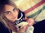 Bundle of joy: Cara Delevingne managed to carve out some time in busy schedule to enjoy some quality time with her nephew on Sunday