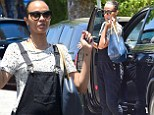 Zoe Saldana covers up her stomach in bulky black overalls to run errands in LA amidst pregnancy speculation