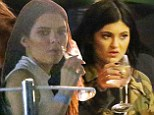 Kendall Jenner, 18, appears to be sipping champagne while Kylie, 16, sticks to water at sister Khloe's 30th birthday bash