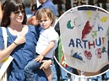 He's plane-ly talented! Selma Blair proudly shows off son Arthur's artwork on a homemade bag at the Farmer's Market