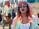 She¿s known for her vibrant take on fashion. And Lily Allen wasn¿t letting the Glastonbury rain get her down as she wowed in a rainbow-hued outfit.