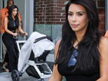 She can't resist! Kim Kardashian picks an elegant skirt for outing with baby North... but still flashes some flesh in crop top