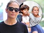 It¿s a twin thing! Max and Emme hug as doting mother Jennifer Lopez treats them to ice cream