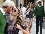 Sealed with a kiss! Gisele Bunchden and Tom Brady keep the love alive with an intimate date in New York