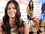 Adriana Lima displays her seemingly endless legs in striking mini-dress as she promotes Desigual's new Life Is Cool campaign in Barcelona