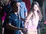 Selena Gomez taken away in handcuffs after Behaving Badly in new film... as it's revealed the star's friends aren't happy that Justin Bieber will attend her birthday bash