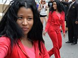 Nicky Minaj looks comfortable in a red velour Juicy Couture tracksuit after insisting there is no feud with Iggy Azalea