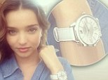 She's a timeless beauty! Baby-faced Miranda Kerr, 31, pouts for selfie as she flaunts crystal encrusted designer watch