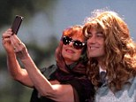 'I look like the guy from White Snake!' Jimmy Kimmel recreates famous Thelma & Louise selfie with Susan Sarandon complete with dodgy wig and beauty spot