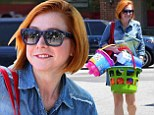 Alyson Hannigan shows off new short, orange-coloured 'do as she hits the market to buy some beach toys