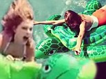 'There is only ONE ninja turtle in town!' Taylor Swift jumps into swimming pool on flotation device as she larks around with pal Jaime King in new video