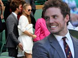 Hunger Games star Sam Claflin gives wife Laura Haddock a playful pat on the bum as they attend Wimbledon
