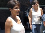 Halle Berry nails off-duty chic in white blouse and baggy jeans as she arrives on the set of new sci-fi series Extant