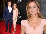 No one's looking at your dress! Geri Halliwell flashes ample chest in figure-hugging pink number as she heads to F1 party with boyfriend Christian Horner