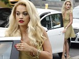 Don't forget your coffee! Rita Ora leaves hot drink on car roof after Berlin shopping spree while wowing in yellow floaty dress and gold heels