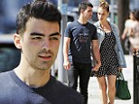 The look of love! Joe Jonas and girlfriend Blanda Eggenschwiler hold hands as they gaze at each other while on a stroll