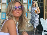 Glamorous maximus! Ashley Tisdale displays signature style in gladiator sandals on beverage run in LA