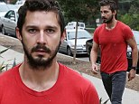 Shia LaBeouf looks troubled as he steps out in bright red shirt... day after his rep confirms he's getting treatment for alcoholism