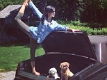 Would PETA approve? Hilaria Baldwin puts her pooches in a car TRUNK for latest kooky yoga pose... but she has a message to go with it