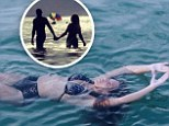 What marriage troubles? Beyonce wears bikini as she floats serenely in the ocean... before holding hands with Jay Z in picturesque vacation snaps