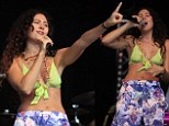 Eliza Doolittle bares her cleavage in a skimpy neon-green crop top as she leads performers at the Hop Farm Festival