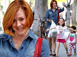 My little show-offs! Alyson Hannigan's mini-me daughters get in on the act on spirited run to the grocery store