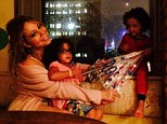 Staying warm inside: Mariah Carey shared a snap cosying up with her three-year-old twins, Monroe and Moroccan, while it rained and thundered in New York City on Thursday
