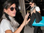 Fan favourite: Sandra Bullock waves as she prepares to depart on Thursday from Los Angeles International Airport