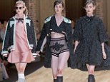 Models with 'bruised knees' strut down the catwalk in Barcelona