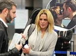 Michael Morris and wife Mary McCormack look to have put past behind them as they jet out of LAX... months after director was snapped kissing Katharine McPhee